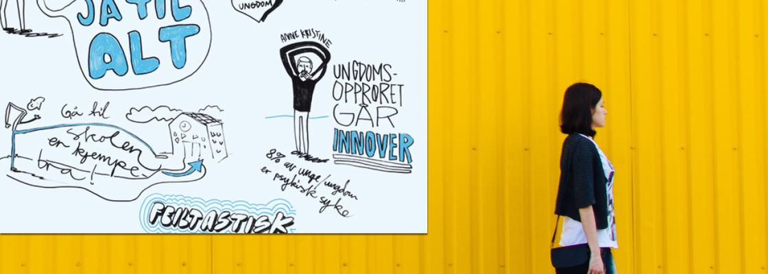 Illustrasjon til sak om ungdomshelse. Jente foran gul vegg.