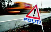 Politiskilt langs vei, arrangert av UP