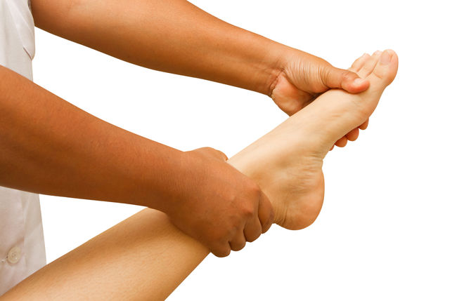 a physio therapist  test the foot and ankle
